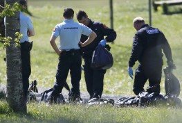 French police officers and bomb-disposal experts are seen during investigations in Saint-Pee-sur-Nivelle